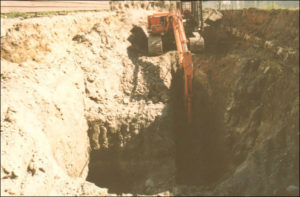 Once testing has determined contamination is present, excavation of contaminated soil can be an effective solution for remediating a site. Here, a deep excavation in dense (till) soil with low water table conditions was needed in an area contaminated by a leaking underground gasoline tank.
